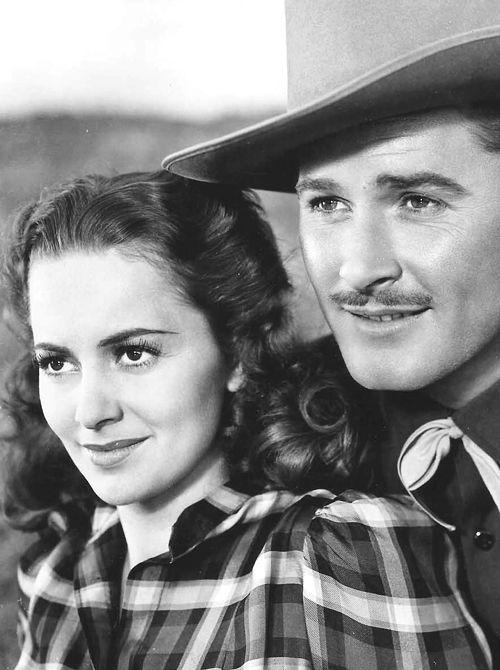 """Errol Flynn and Olivia de Havilland in """"Dodge City"""", 1939"""