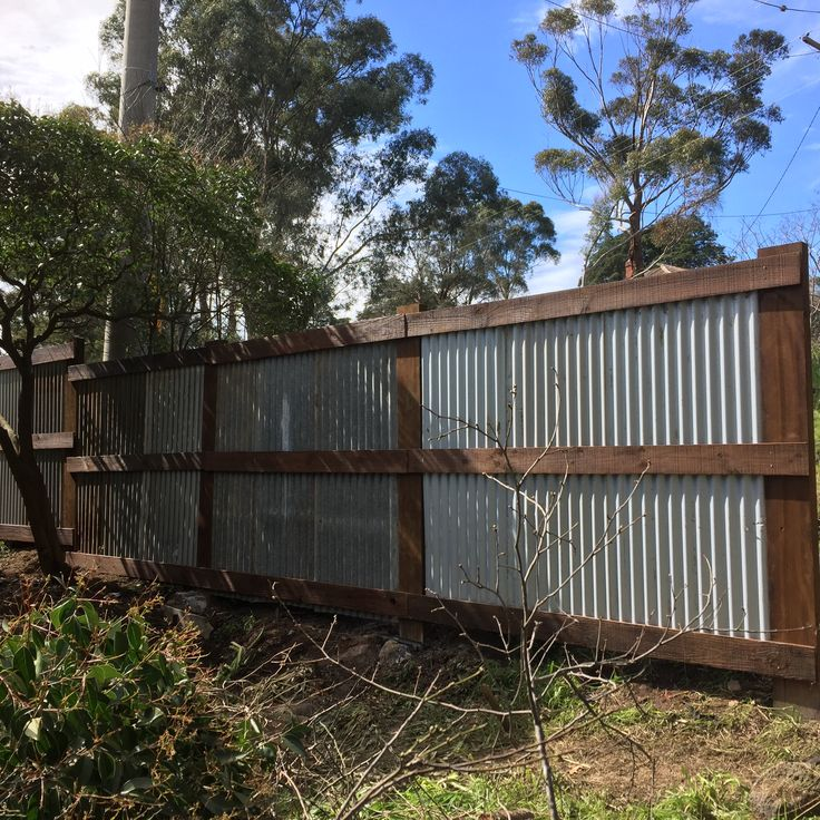 Recycled Stained Boards And Corrugated Iron Collected From
