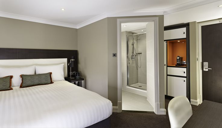Accessible Guest Room which features one queen-sized bed with crisp cotton linen, soft duvet and comfy pillows. This room also benefits from Freeview channels on the 40-inch LED TV, climate control, ironing facilities, a work desk, hair dryer and tea/coffee making facilities.