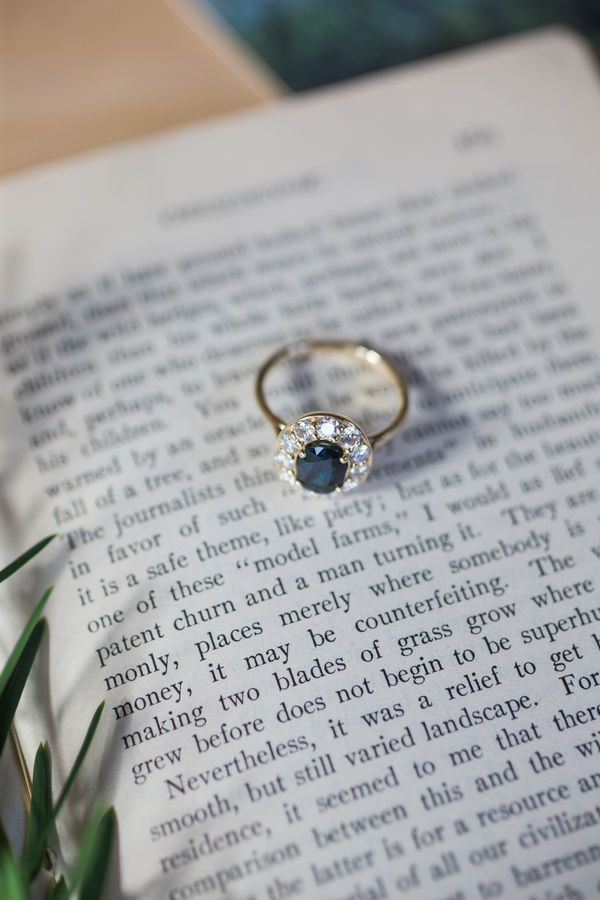 Elyce and Tyler's Whimsical New Hampshire Wedding by Rodeo & Co. Photography   A blue sapphire engagement ring with a diamond halo and gold band.
