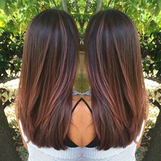 It works really well if you start with a chocolate brown base and add in some lovely bright pink streaks… | 21 Delightful Ideas For Lightening Your Hair Without An Ombre
