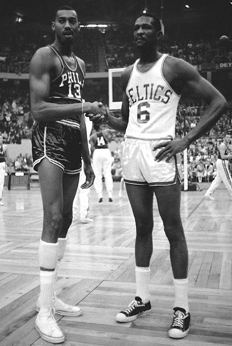 Wilt Chamberlain and Bill Russell  1959  Wilt Chamberlain shakes hands with Russell in 1959. The rivals battled repeatedly in the postseason, with Russell's team usually coming out on top.