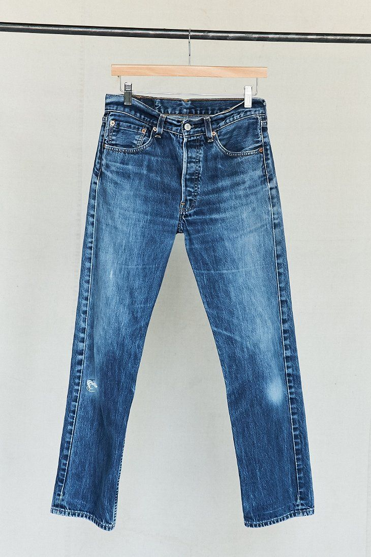Vintage Levi's 501 dark wash jeans in a classic 5-pocket design with a button-front. Cut in a relaxed fit with some authentic worn detailing on the legs. Excellent vintage condition. We only have one of these rare finds, so get it or regret it!