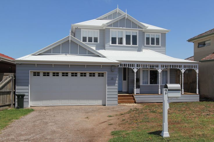 Two Story Hampton in James Hardie Summit weather boards. Colorbond Surfmist roof. Gliderol garage door with Country windows