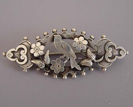 VICTORIAN sterling silver hallmarked 1894 bird brooch with floral and leaf design