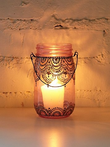 Hand-decorated mason jar lanterns. So cute with a lit candle inside and hanging on wire across your backyard. Also make beautiful table top decorations