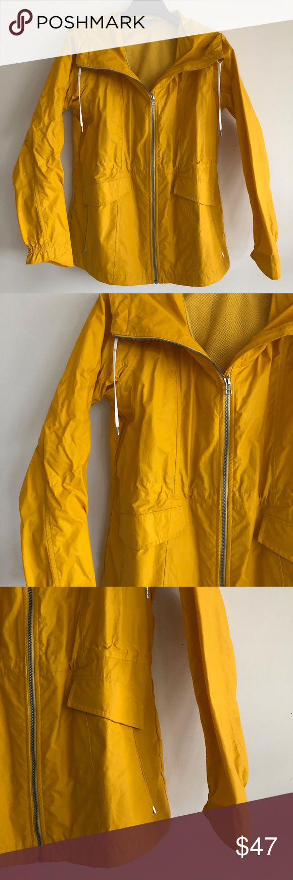ATHLETA yellow rain parka ATHLETA yellow rain parka. Worn twice, cant even tell. Adjustable waist inside. 2 front pockets and inside pockets. White drawstring cord on hood. Athleta Jackets & Coats Utility Jackets