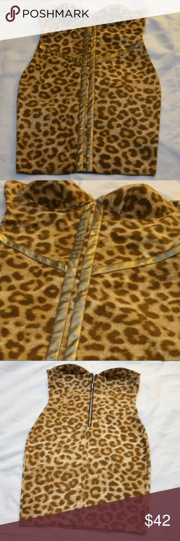 Kardashian Kollection Leopard Convertible Dress L Curve-hugging style and sexy leopard print Kardashian Kollection women's body-con dress. Molded cups and metallic taping will flatter your shape to the max, letting you go bare-shouldered and bold! Removable shoulder straps missing. Sweetheart neckline, molded cups. back zipper closure. Clasp above zipper missing. All shown in photos.   Hemline: 31 in. from the neckline Fabric: 96% polyester, 4% elastane Kardashian Kollection Dresses…