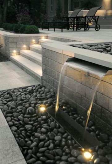like the water blade, and lighting on steps. Water feature and exterior lighting designed by Paver Planet, Inc. #steplights #fountainlights