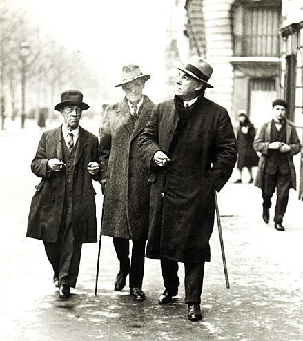 "Paris, 1929. Joyce himself captioned this photo ""Three Irish Beauties."" From left to right: author James Stephen, James Joyce, tenor John Sullivan."