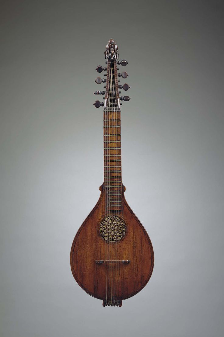 English cittern, circa 1600. A stringed instrument dating from the Renaissance, descended from the Medieval citole, or citole. Its flat-back design was simpler and cheaper to construct than the lute. It was also easier to play, smaller, less delicate and more portable. Played by all classes, the cittern was a premier instrument of casual music making much as is the guitar today.
