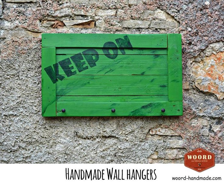 Handpainted wooden wall hanger from reclaimed wood in green color with handwritten dark blue letters and 3 big nails.