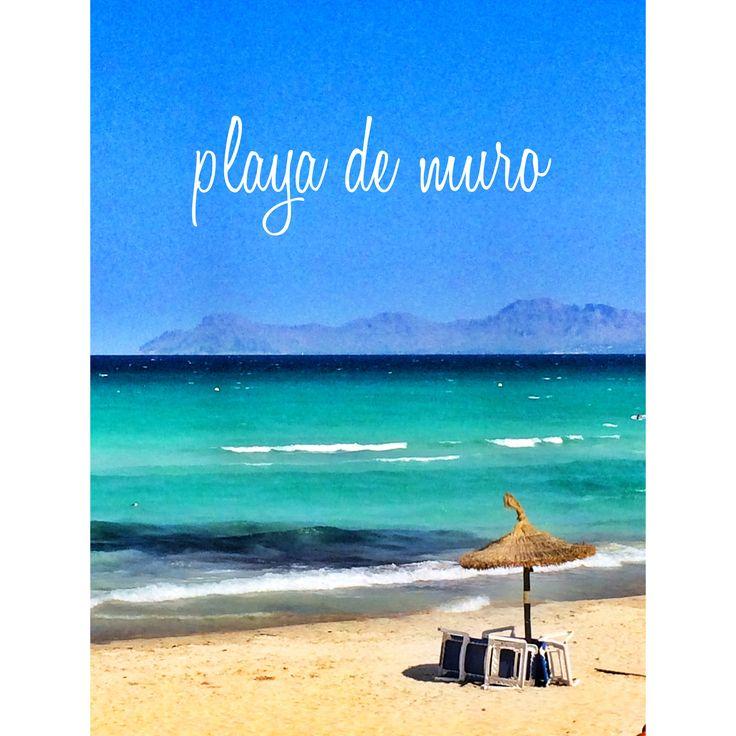 The Beach of muro in mallorca. Green water, sun, relax...