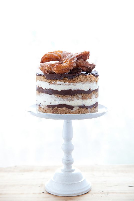 momofuku inspired churro cake; momofukus amazing brown butter cake (made also with oil, buttermilk) is flavored with brown sugar and cinnamon; layered with homemade jenis creamy eggless vanilla bean ice creamy; silky chocolate ganache; and from scratch fried churros and churros crumbles