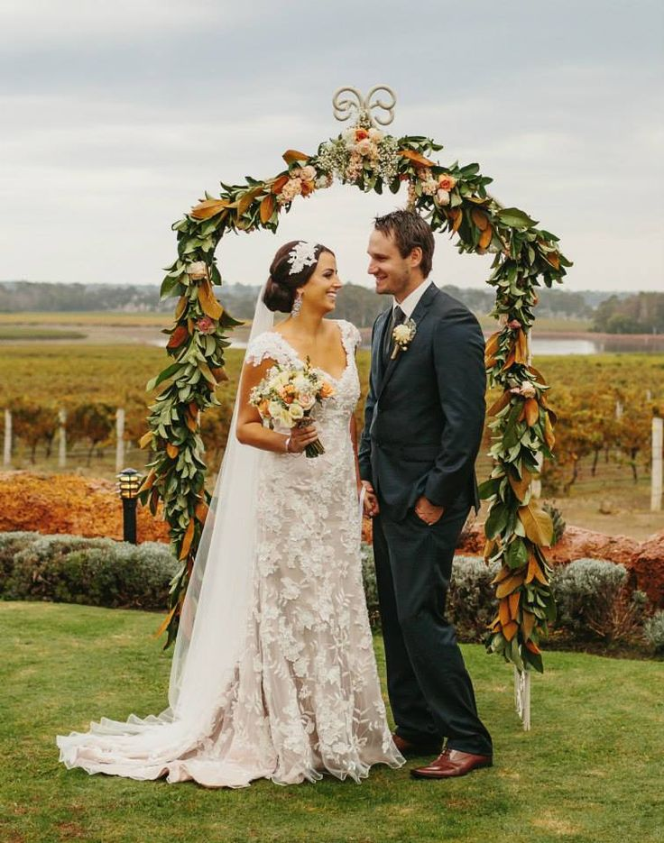 Magnolia, rose & carnation arch at Watershed Winery Margaret River, flowers by Scentiment Flowers, photography by Bianca Kate Photography