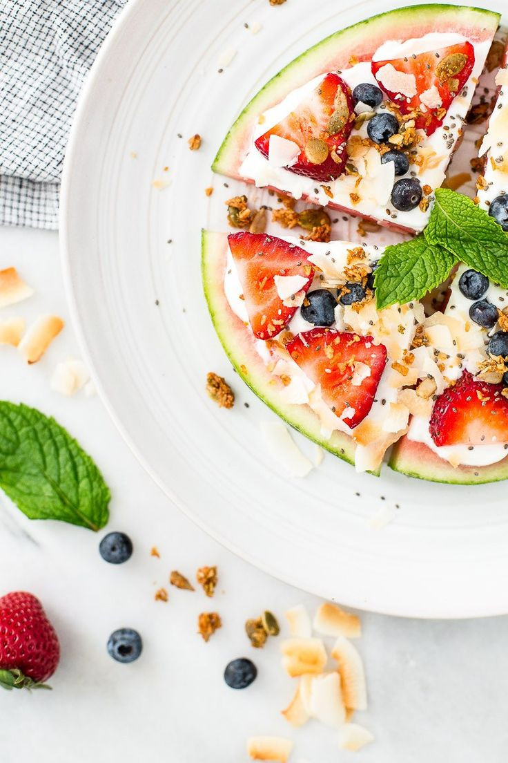 A refreshing summertime snack using sliced watermelon topped with coconut yogurt, toasted coconut flakes, fresh berries, and paleo granola. Perfect for picnics and barbecues! | VEGAN + PALEO + RAW OPTION | via Honestly Nourished