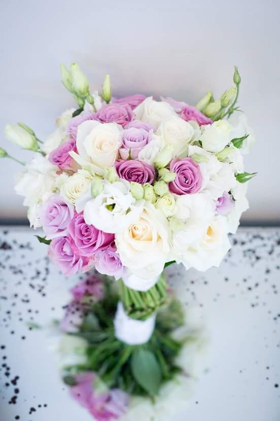 Hand tied bouquet of Cool Water, Ocean song and white avalanche roses and lisianthus. Thanks to Kathryn-van-Eck-Photography
