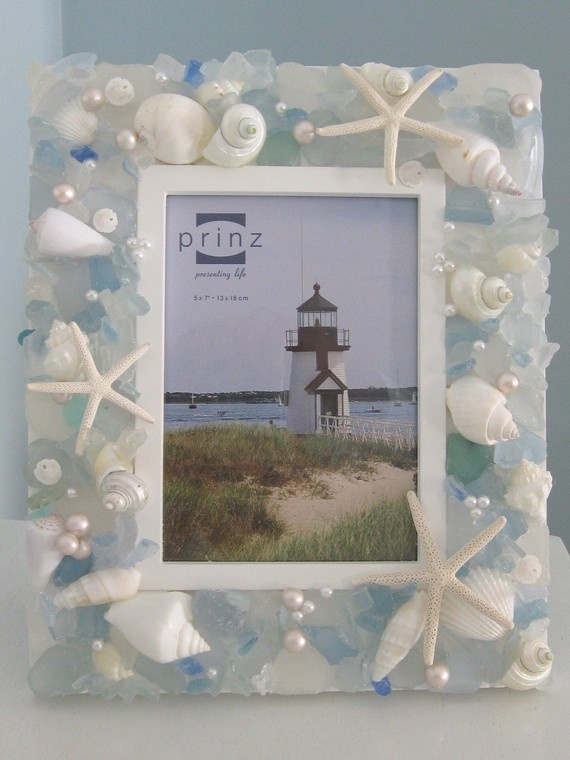 We could do this for the mirrors!   Shell Frame.  This is not hard to make into your own creation. Just some seashells and a frame few scattered pearls. Lovely. We could do this for the mirrors