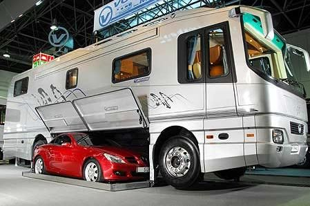 A wonderful traveling experience. Costs only 2.5 million. Your car fits right in the undercarriage. No more towing behind. I wonder what kind of gas mileage it gets?