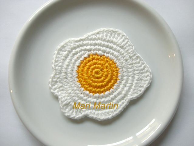 Crochet Coasters Eggs. Looks like a crochet spiral with a bit of freeform crochet around the edges. Easy enough and I Love it!
