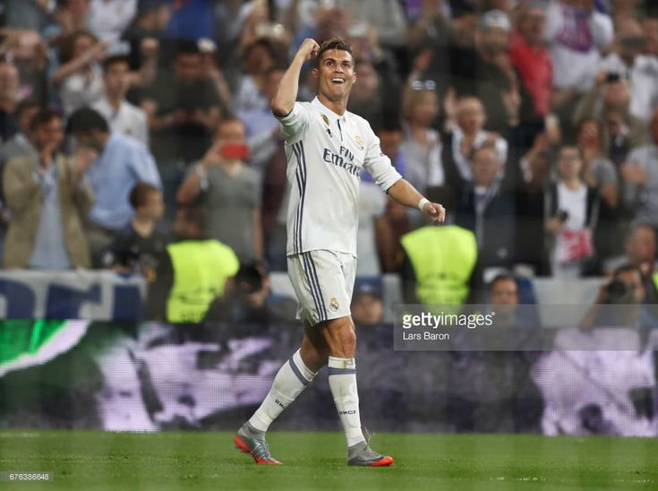 Cristiano Ronaldo of Real Madrid celebrates as he scores their third goal and completes his hat trick during the UEFA Champions League semi final first leg match between Real Madrid CF and Club Atletico de Madrid at Estadio Santiago Bernabeu on May 2, 2017 in Madrid, Spain.