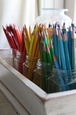 Use glass jars to organize colored pencils and markers by color - Great way to organize an artist's workspace. Makes it easy to grab the color you need, I do this!!