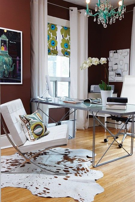 There's nothing corporate-feeling about this home workspace, with its chocolate-brown walls, chandelier and Marimekko Unikko roman blind. The resulting design is well-travelled, personal and inspiring.