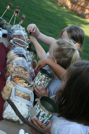 Camping Party -- trail mix bar.  Kids can make their own concoction with different snacks.