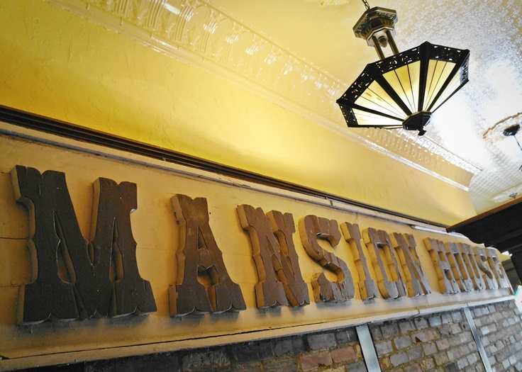 """Original sign for the """"Mansion House Hotel"""" in Stratford Ontario, now The Parlour"""