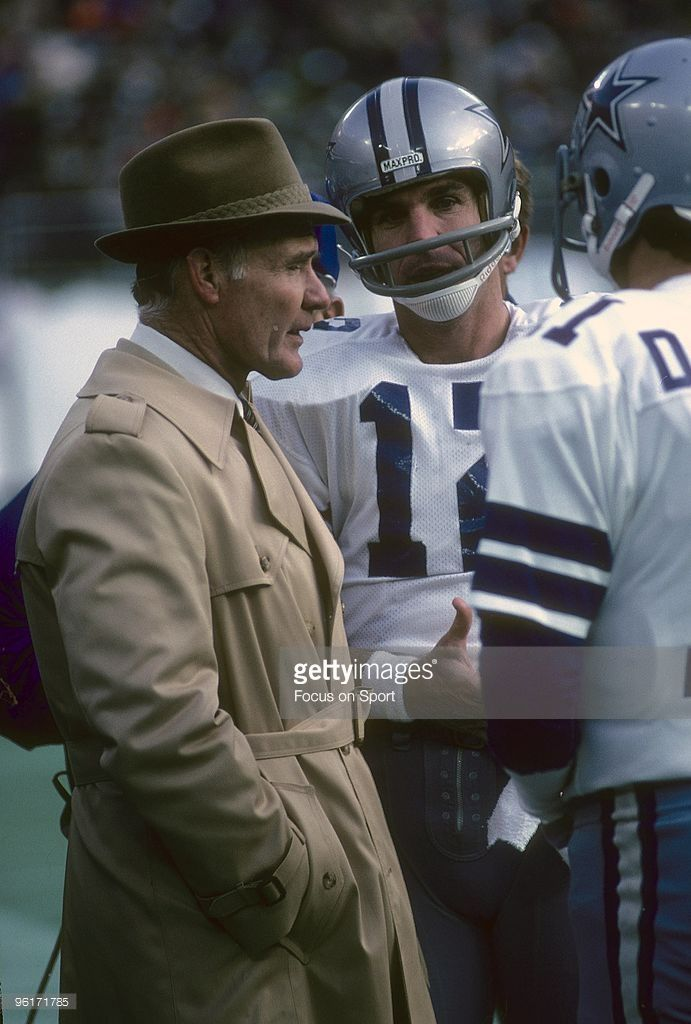 Head coach <a gi-track='captionPersonalityLinkClicked' href='/galleries/personality/240241' ng-click='$event.stopPropagation()'>Tom Landry</a> (L) of the Dallas Cowboys talks with his two quarterbacks <a gi-track='captionPersonalityLinkClicked' href='/galleries/personality/208812' ng-click='$event.stopPropagation()'>Roger Staubach</a> #12 and Danny White #11 during a late circa 1970s NFL football game. Landry coached the Cowboys from 1960-88.