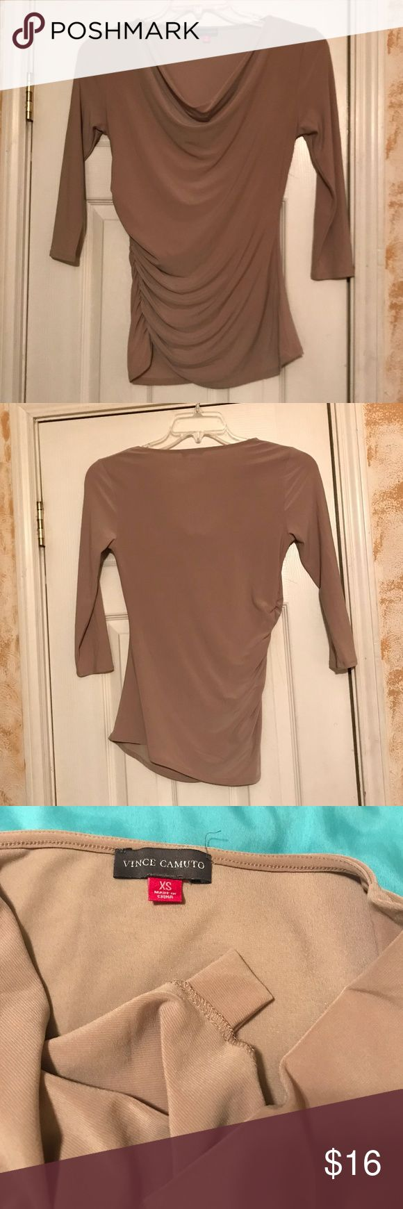 "Size XS Vince Camuto Sexy Nude Fitted Long Sleeve Size XS Vince Camuto Sexy Nude Fitted Long Sleeve Top  Previously owned and worn very gently!  Sexy AF stretchy and fits perfectly!  Nude colored extra small ruched on the sides long sleeve top.  Slight pilling but not noticeable at all! Bust (pit to pit) 15"" Length (shoulder to bottom) 25"" Pictures are part of description! Vince Camuto Tops Blouses"