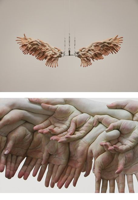 Xooang Choi — The Wings, 2009: oil on resin, stainless steel, 172x48x56cm. The hands look uncannily, eerily real.