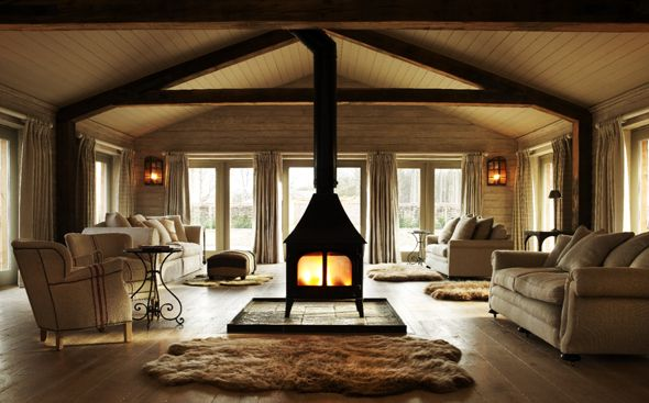 Cosy sitting room with double sided wood burner