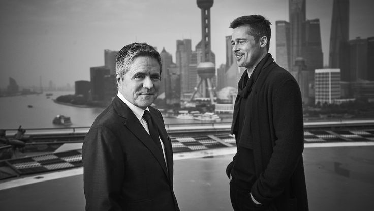 Brad Pitt Descends on Shanghai to Promote 'Allied' (Photos)  The actor was joined by Paramount Pictures chairman and CEO Brad Grey for a pair of red carpet events.