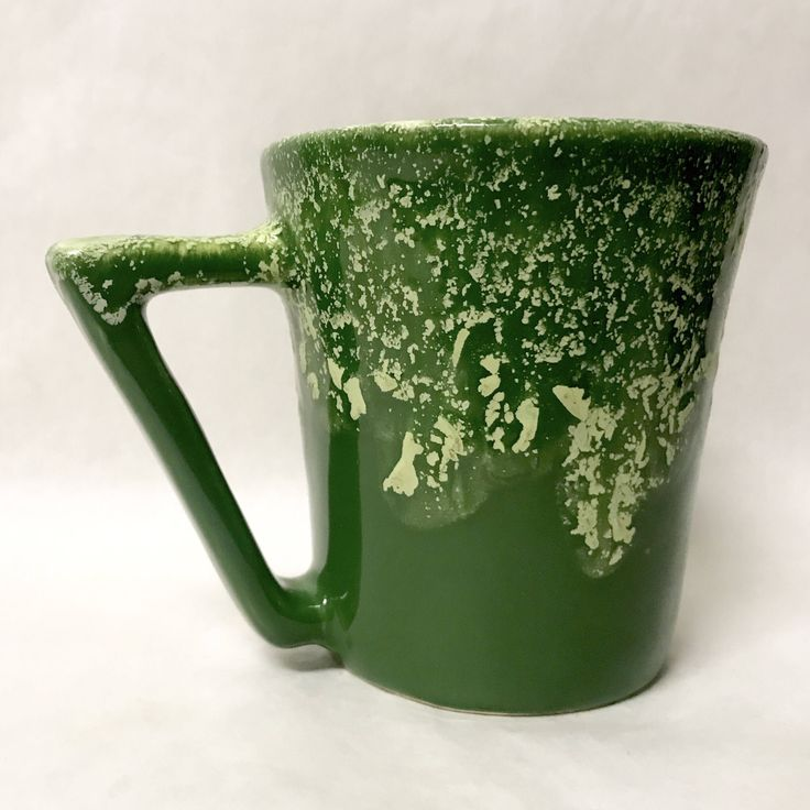 A personal favorite from my Etsy shop https://www.etsy.com/listing/552512884/vintage-winart-pottery-green-mug-yellow