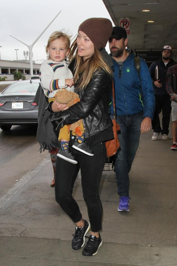 Olivia Wilde wearing Proenza Schouler Ps1 Bag, Balenciaga Leather Jacket and Adidas Energy Boost Sneakers