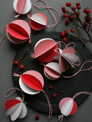 handmade ornaments. cut 6 circles and fold in half gluing back to each other. insert twine before gluing last 2 together.