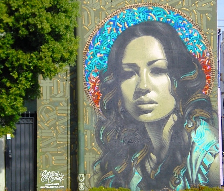 #LA Street Signs- Jolie; This mural on Pico Boulevard (between Orange Grove Avenue and Ogden Drive) in West Los Angeles was a collaboration between El Mac, Retna and Estevan Oriol. Based on a portrait of model Joli Robinson taken by Oriol, the mural's background was designed by Retna and the spraypaint work was done by El Mac.