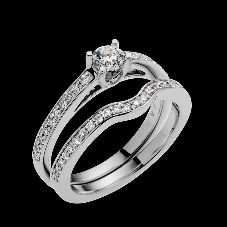 """""""Empress"""" is setoff with the diamonds on the pavilion, below the center round brilliant diamond. This ring has a 0.25 carat round brilliant center diamond."""