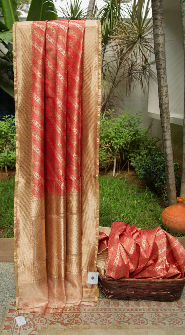 This bright cherry red benares net sari is handcrafted by the finest weavers in benares. This sari has a closely-woven abstract pattern in gold zari and dull gold zari. The complementing border and…