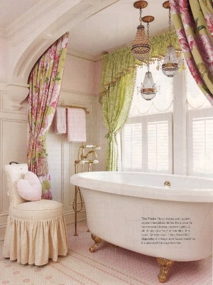 Pink and green feminine bath. Double curtains. Penny tile flooring. Claw foot tub. Multi-chandeliers. Atticmag.com
