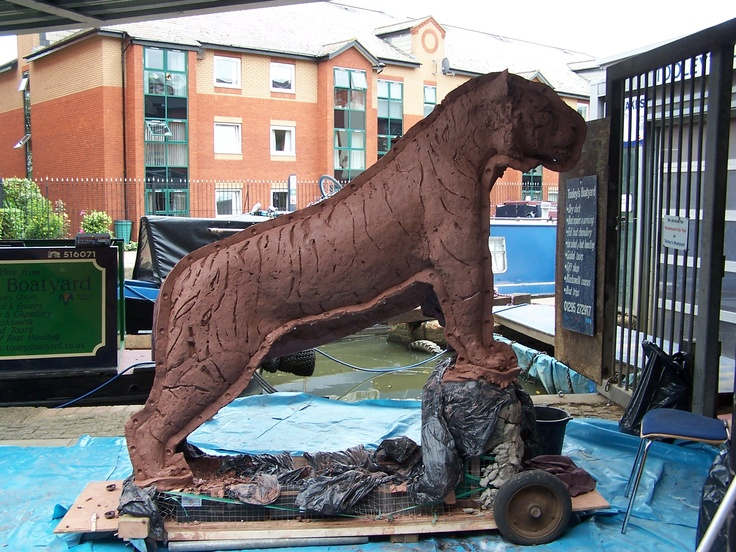 Preparing large clay tiger for casting