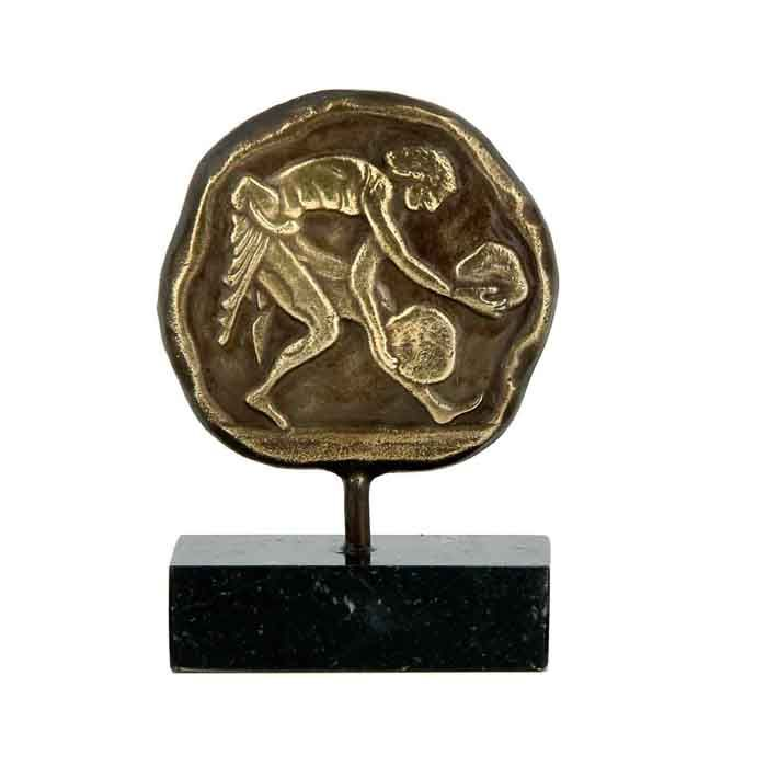 Weight lifting is one of the events in the modern Olympic Games. In ancient Olympia, it was an athletic event, that was used as an exercise for the athletes of the Pentathlon or the Pankration. We created a bronze relief plaque, depicting the event of weight lifting.   500 B.C., Ancient Olympia  Dimensions: 7cm x 11cm x 3,5cm  Bronze with patina, on a greek black marble base, with white and grey waters.