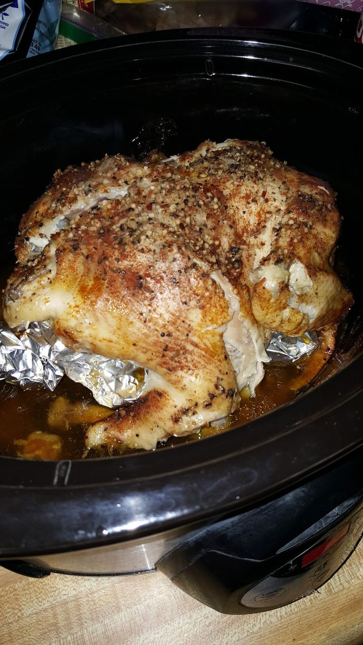 Tonight I decided to make a whole chicken for dinner. Instead of roasting I decided I would just season it, toss it in the Crock-Pot, and let it cook in it's own juices. The result was delish! The skin isn't quite as crisp as a store bought Rotisserie but it was moist and tender and perfectly cooked after just 4.5 hrs!