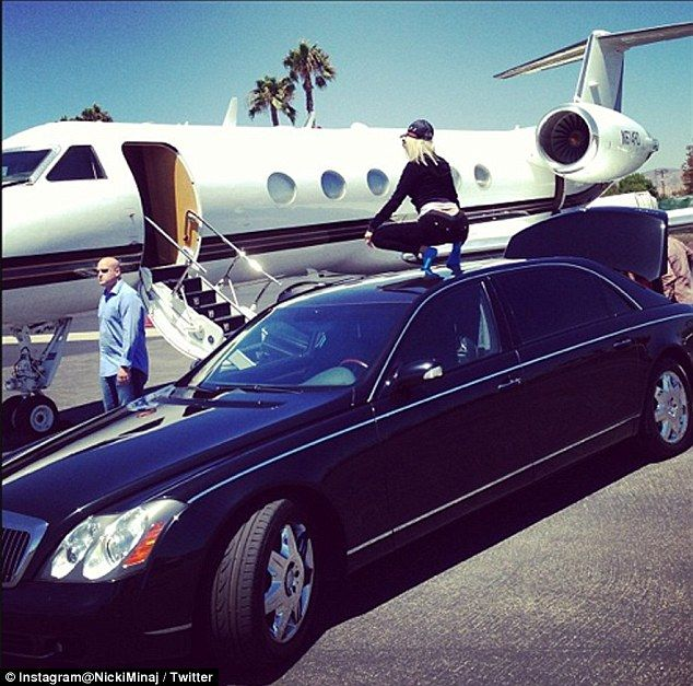Rooftop bounce: Nicki Minaj perched herself on a limo to demonstrate her twerking skills before boarding a plane to Miami, on Thursday