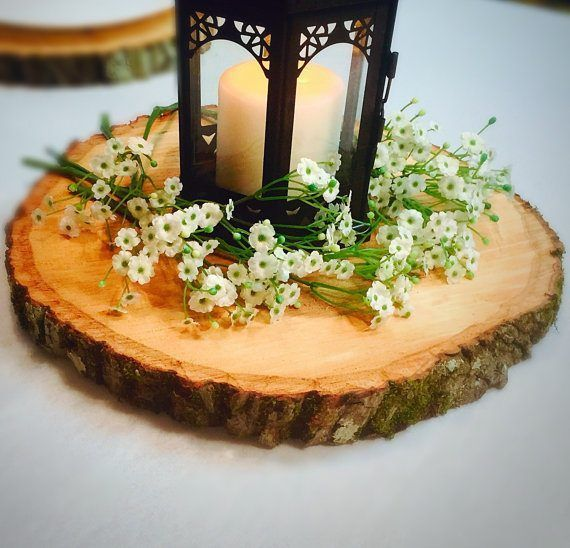 Rustic wood slices for decoration at weddings and bridal showers | via Wood Themed Wedding Ideas: http://emmalinebride.com/themes/wood-themed-wedding-ideas/