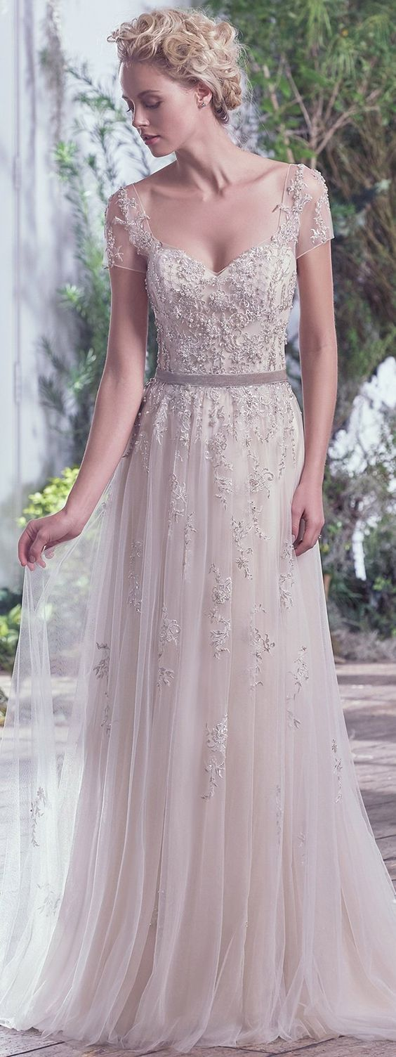 Chic sheer short sleeve bead embroidered sheath wedding dress; Featured Dress: Maggie Sottero