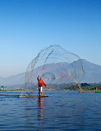 Travel Photographer of the Year 2012 – Michael Theodric, Indonesia (age 10) – winner, young travel photographer, 14 and under (places & faces). A fisherman casts his net early in the morning, Bagendit Lake, Garut, Indonesia