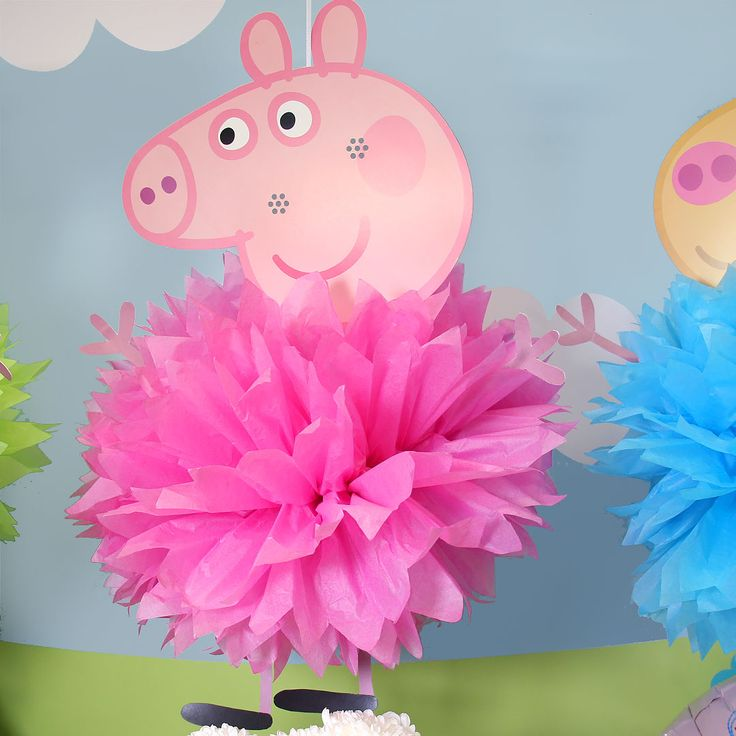 Transform ordinary pink pom poms into Peppa Pig pom poms! Simply attach a Peppa Pig mask to the top of the pom pom and voilà! The perfect party decoration for a Peppa Pig party theme.