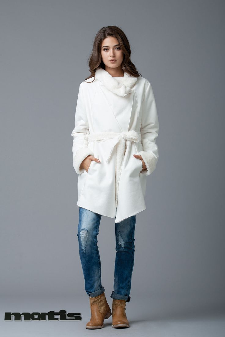Wrapped in style! Throw on a white warm coat to beat the winter chill...